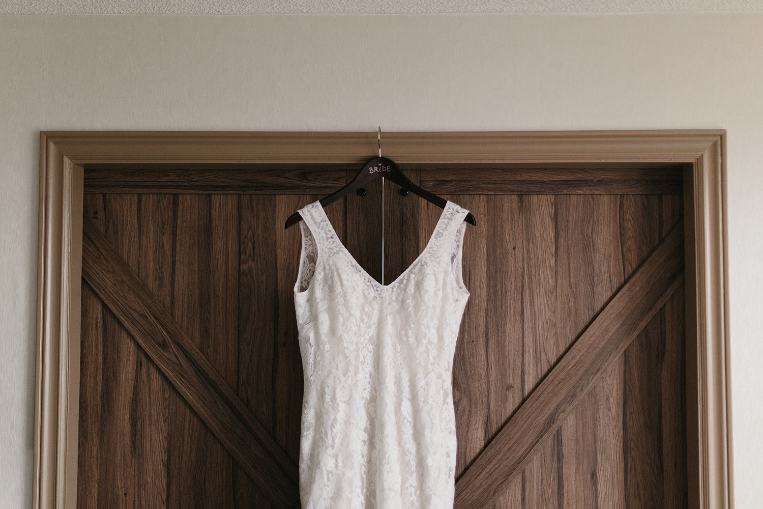 wedding-dress-hanging-on-the-wall-from-allure-bridals-london-ontario-wedding.jpg