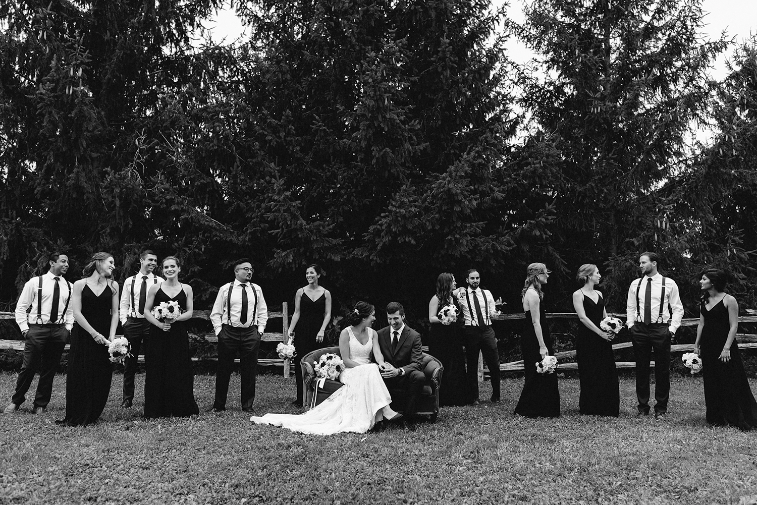 couch-candid-bridal-party-bridesmaids-in-black-dresses-candid-fun-real-moments-at-bellamere-winery-toronto's-best-wedding-photographers-candid-documentary-style-photography-london-ontario-winery-wedding-inspiration.jpg