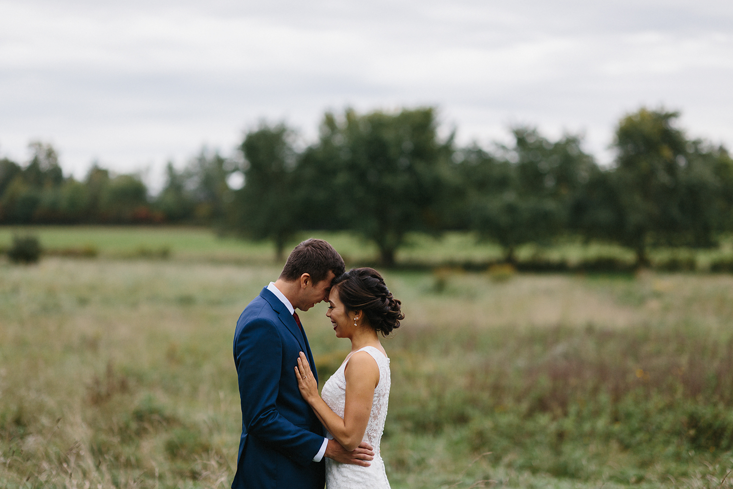 bride-and-groom-portraits-in-field-epic-romantic-moody-real-moments-at-bellamere-winery-toronto's-best-wedding-photographers-candid-documentary-style-photography-london-ontario-winery-wedding-inspiration.jpg