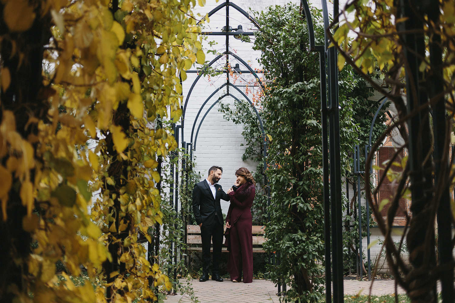 toronto-restaurant-elopement-small-wedding-intimate-portraits-of-bride-and-groom-in-archway.jpg