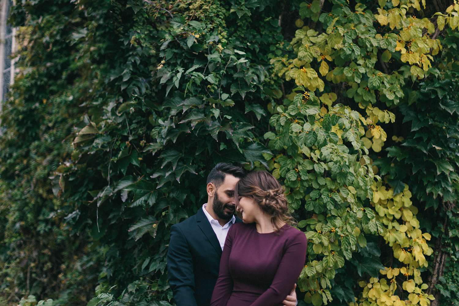 toronto-restaurant-elopement-small-wedding-intimate-portraits-of-bride-in-purple-jumpsuit-old-ivy-buildings.jpg