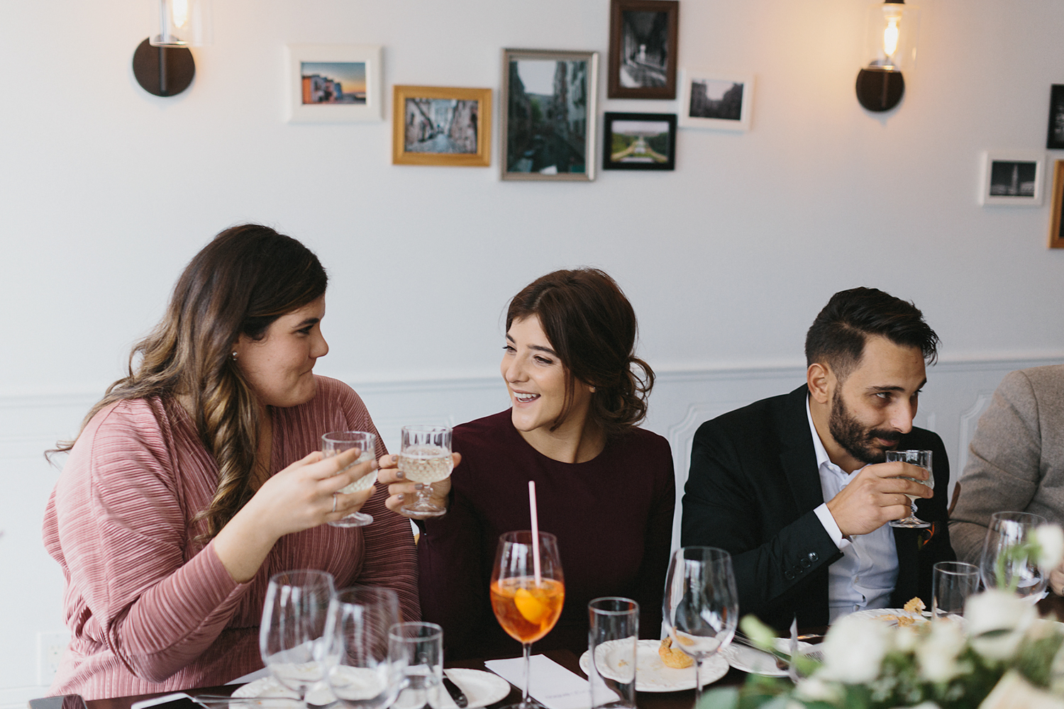 toronto-restaurant-elopement-intimate-wedding--bride-and-sister-guests-cheers-toast.jpg