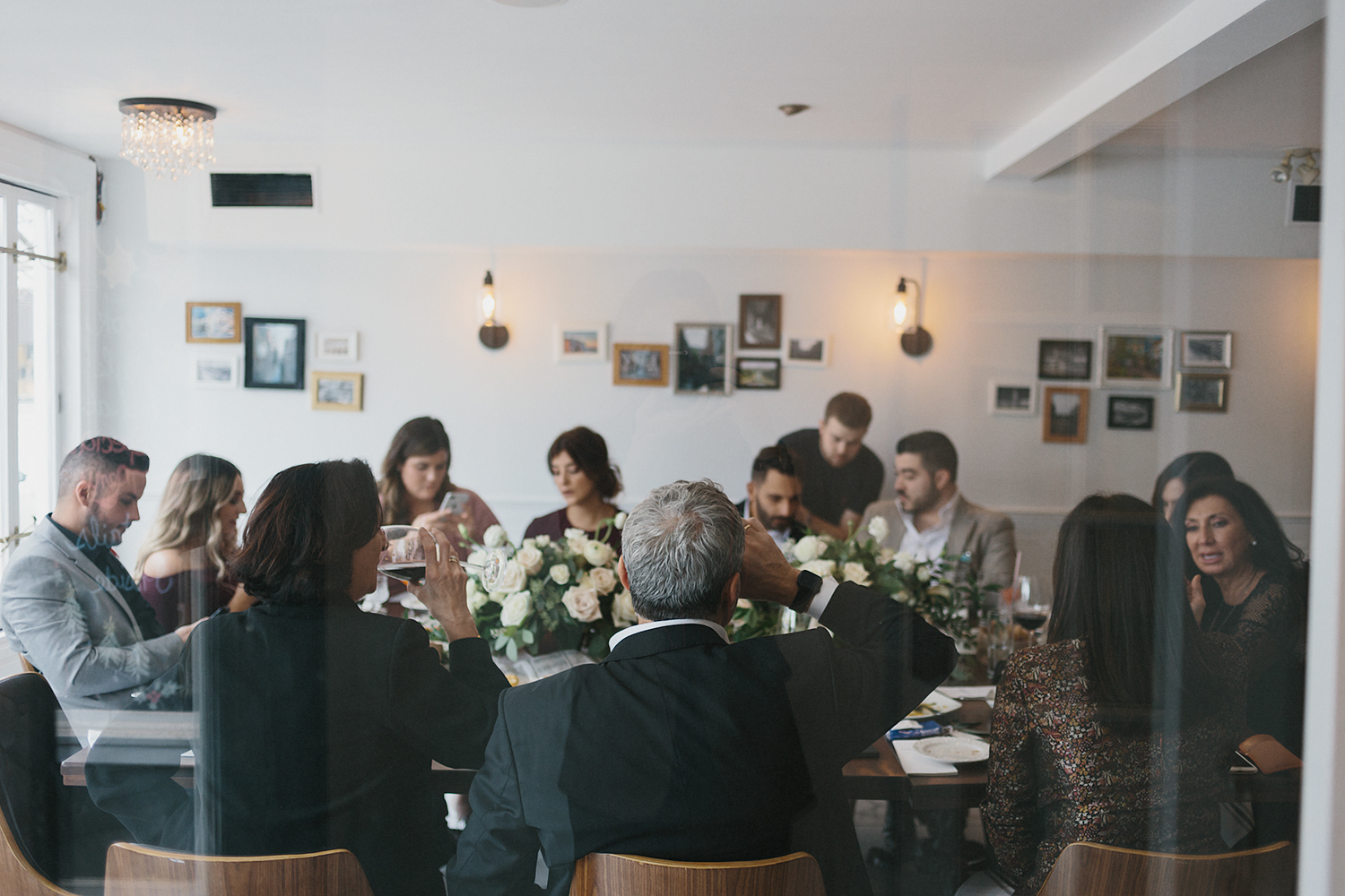 toronto-restaurant-elopement-intimate-wedding-guests-candid-moments-documentary-memories.jpg