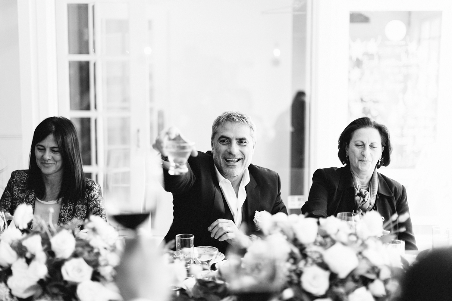 toronto-restaurant-elopement-intimate-wedding-guests-candid-moments-documentary-tablescape-florals-cheers-bw.jpg