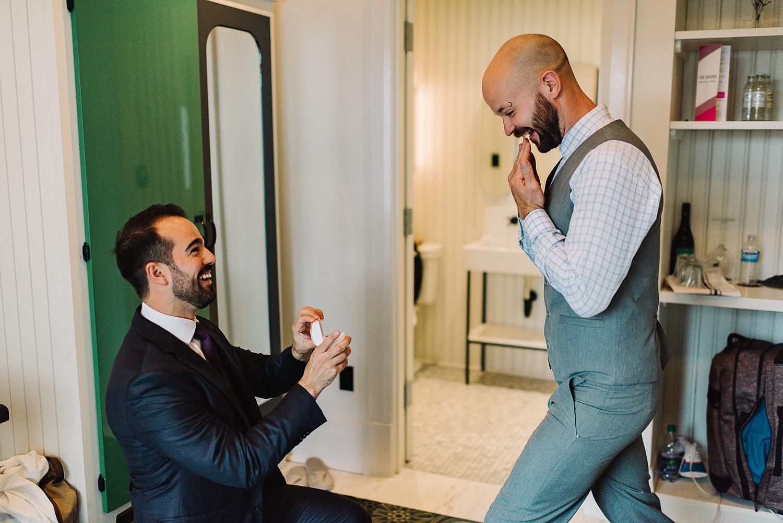 Groom-tying-tie-At-Egaridge-Resort-Venue-Muskoka-Ontario.jpg