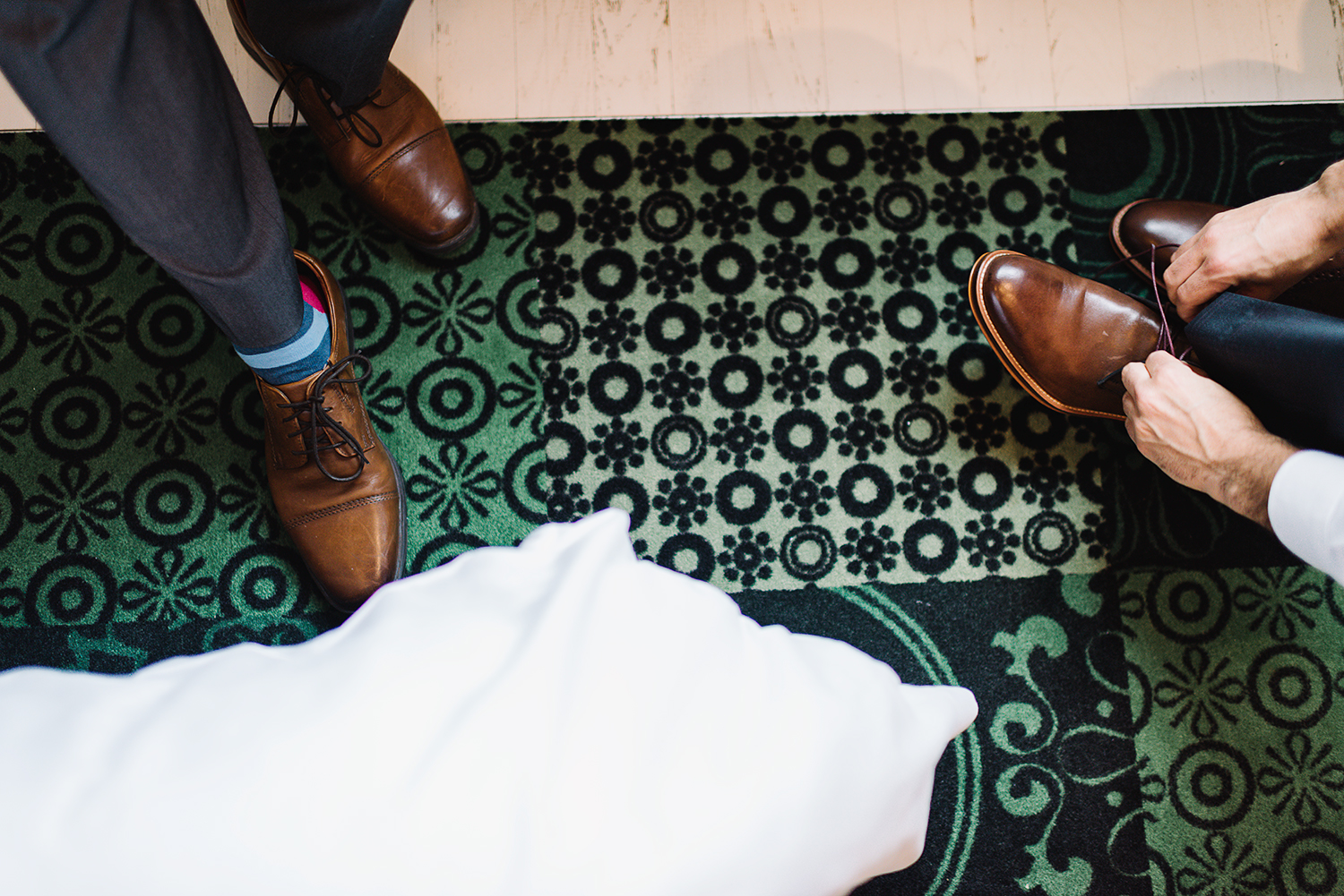 Prince-Edward-County-Drake-Hotel-Elopement-Ryanne-Hollies-Groom-Getting-Ready-tying-shoes.jpg