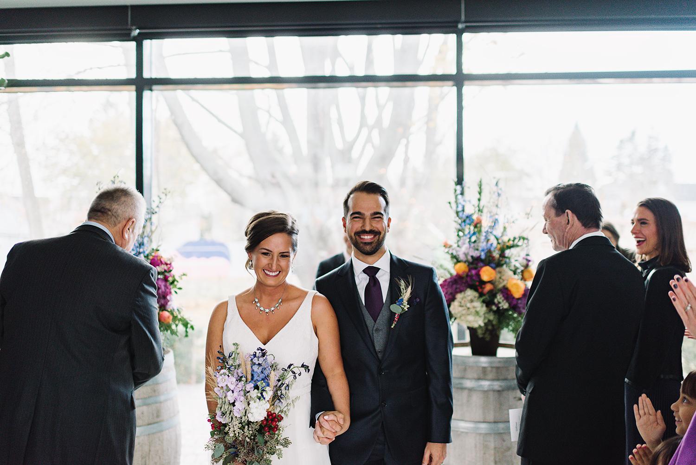 ceremony-dog-walking-down-with-groomsman-At-Egaridge-Resort-Venue-Muskoka-Ontario-Wedding-Photography-by-Ryanne-Hollies-Photography-Toronto-Documentary-Wedding-Photographer.jpg