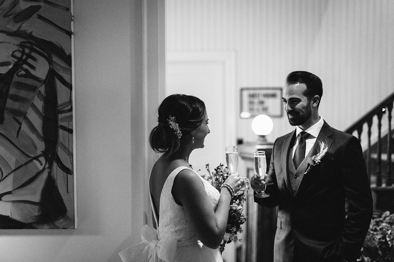 9-ceremony-groom-hugging-dad-At-Egaridge-Resort-Venue-Muskoka-Ontario-Wedding-Photography-by-Ryanne-Hollies-Photography-Toronto-Documentary-Wedding-Photographer.jpg