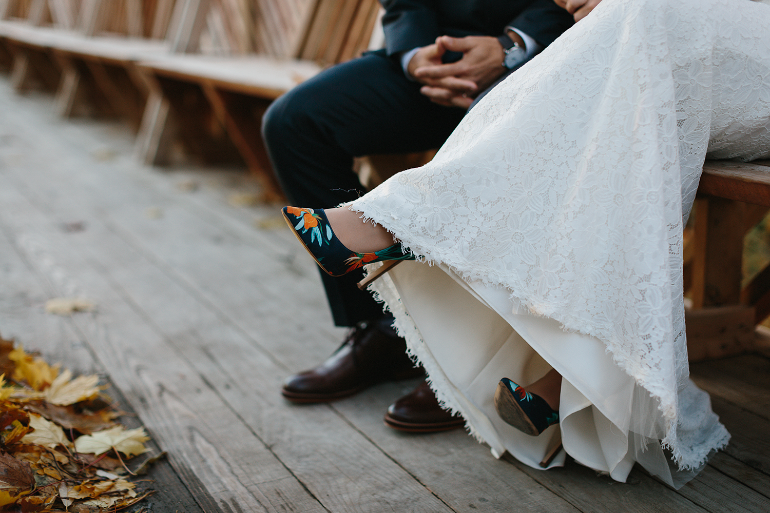 Prince-Edward-County-Wedding-Photographer-Drake-Devonshire-Elopement-Ryanne-Hollies-Photography-junebug-weddings-best-of-the-best-2018-bride-and-groom-portraits-artistic-details-holding-each-other-wood-fence-shoes.jpg
