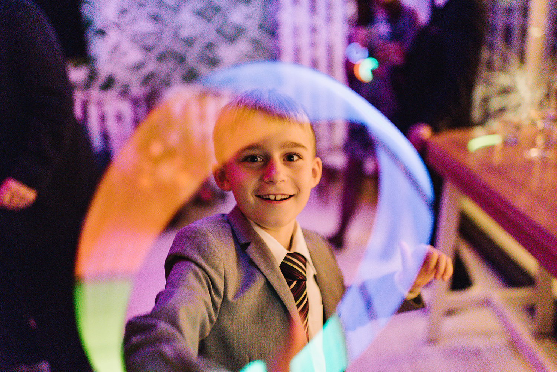 Prince-Edward-County-Wedding-Photographer-Drake-Hotel-Elopement-Venue-Reception-Glow-sticks-detail-Portrait.jpg