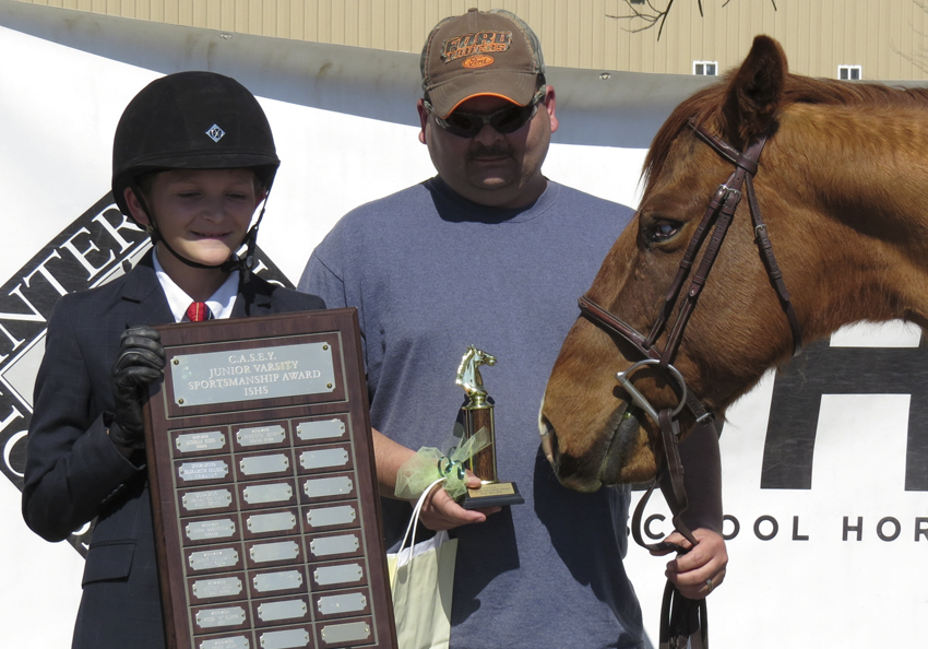 We value sportsmanship and recognize exceptional team players with plaques that are larger than their horse's heads.