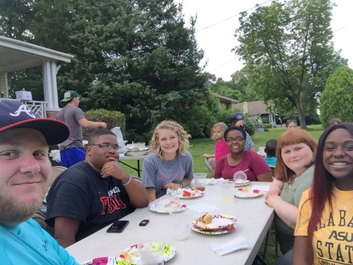 QuadW Missional Interns in Opelika at welcome dinner on their behalf as they begin their summer of living and serving together