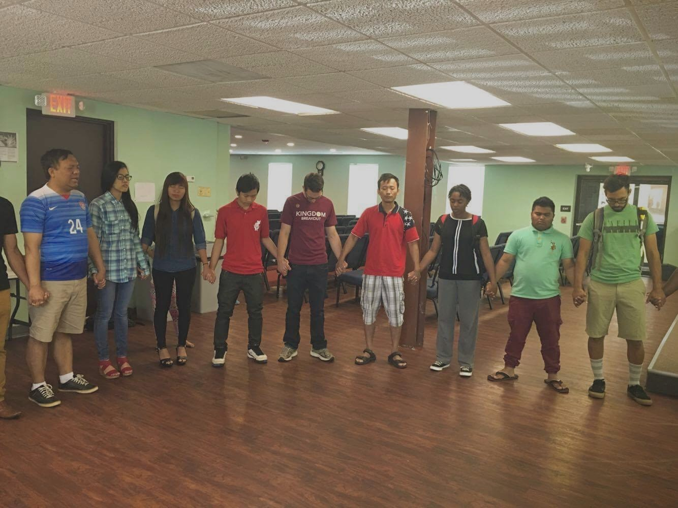 QuadW Columbus interns circle for prayer w/ others in the community