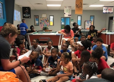 QuadW-Pine-Bluff-intern-reading-teaching-children