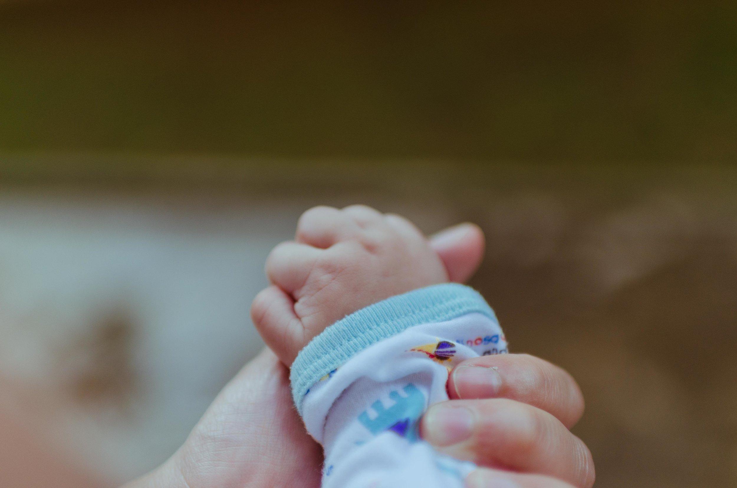 holding-infant's-hand-joy-life-surprise-wonder