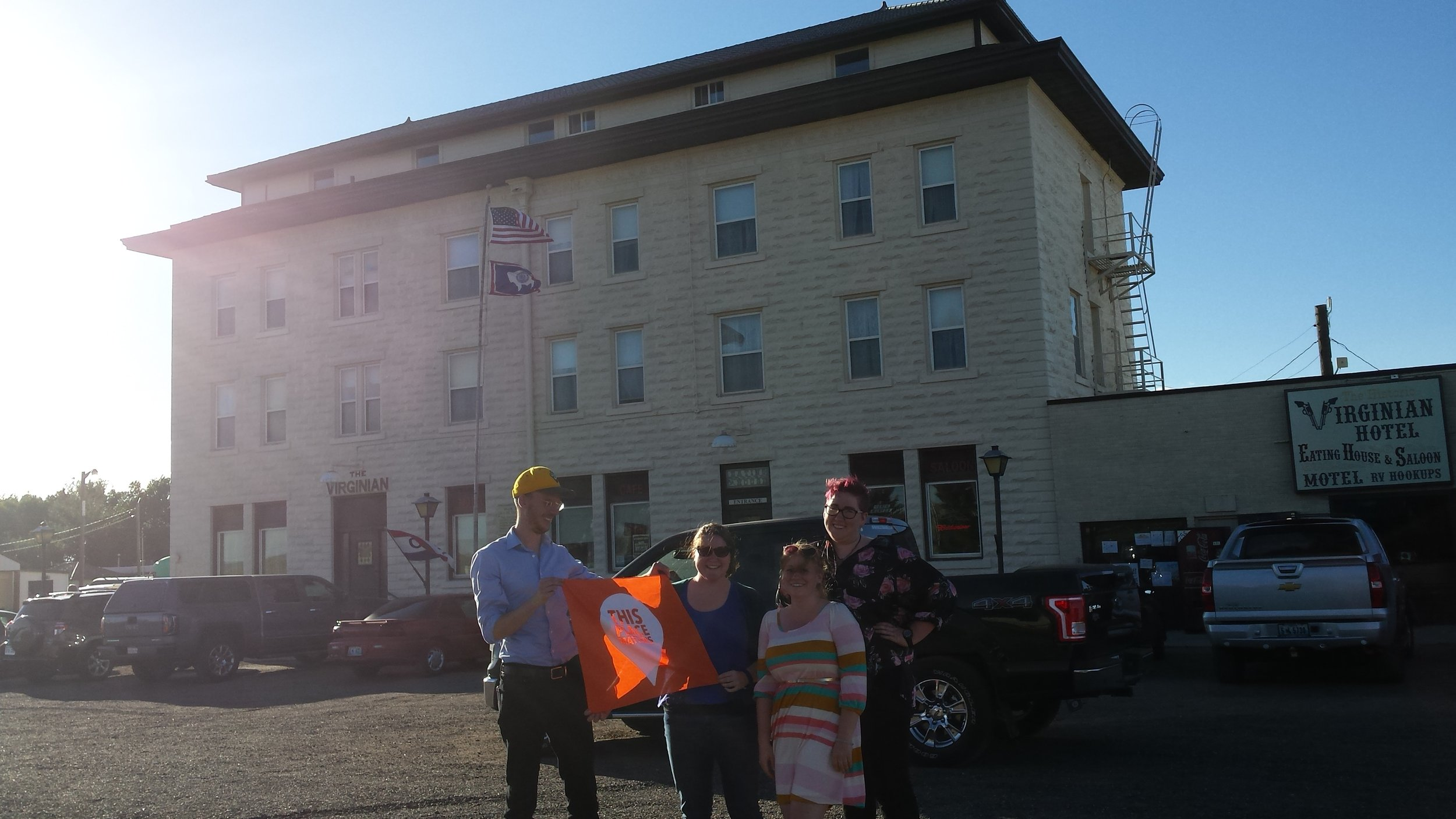"""AHW staff celebrates the Virginian Hotel with a """"This Place Matters"""" banner."""