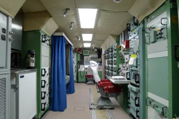 The underground interior of the alert facility conjures images of a submarine