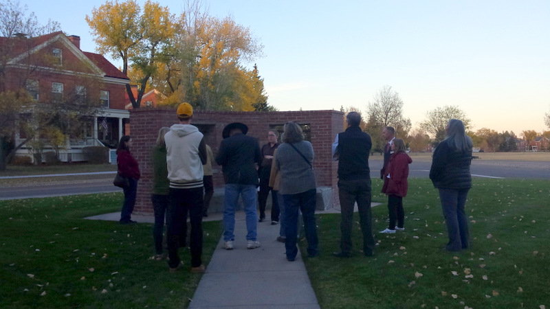 Intern Rine Kasckow tells tour-goers the story of the Balangiga bells during AHW's  Unbarred tour at F.E. Warren Air Force Base