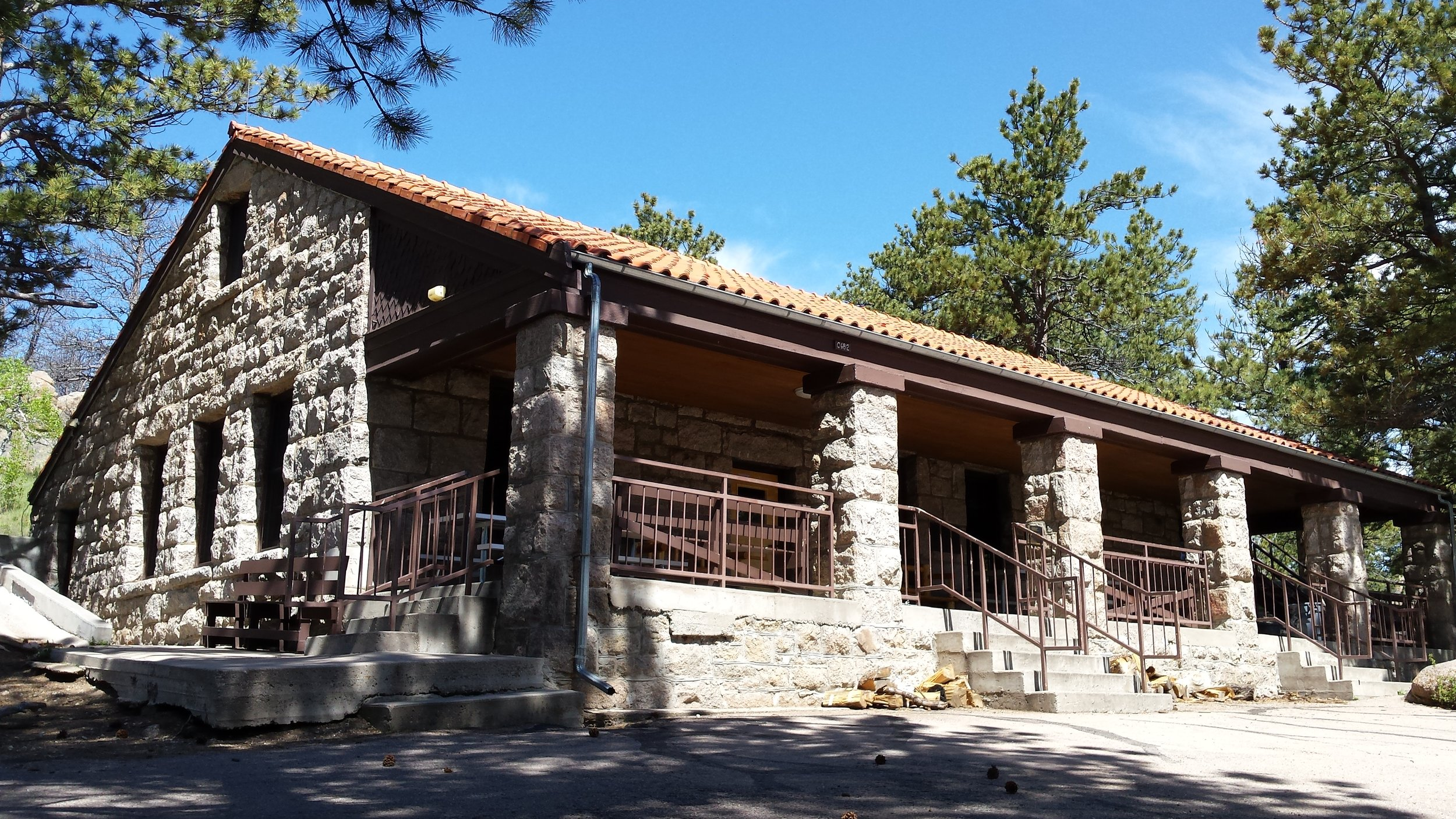 Hynds Lodge is nestled against a hill amongst the trees north of Curt Gowdy State Park