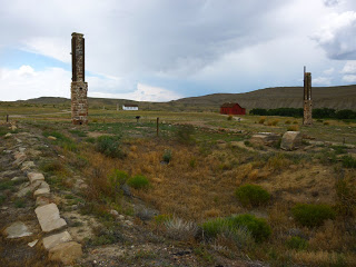 Foundations and chimneys are all that remains of two enlisted barracks. They were converted to hotels for Lincoln Highway travelers before vandals burnt them down on New Years Eve 1976.