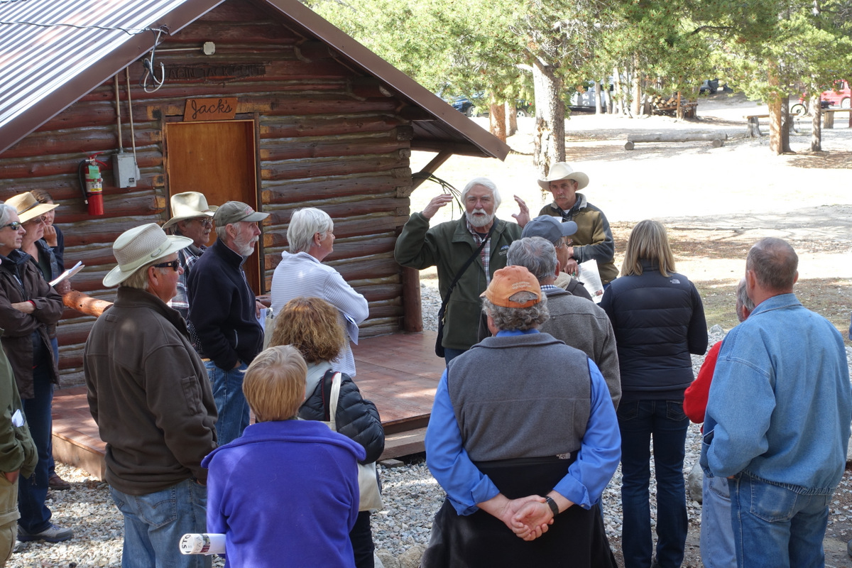 Harrison Goodall conducting a workshop on maintaining and rehabilitating log buildings at Spear-O-Wigwam in Johnson County