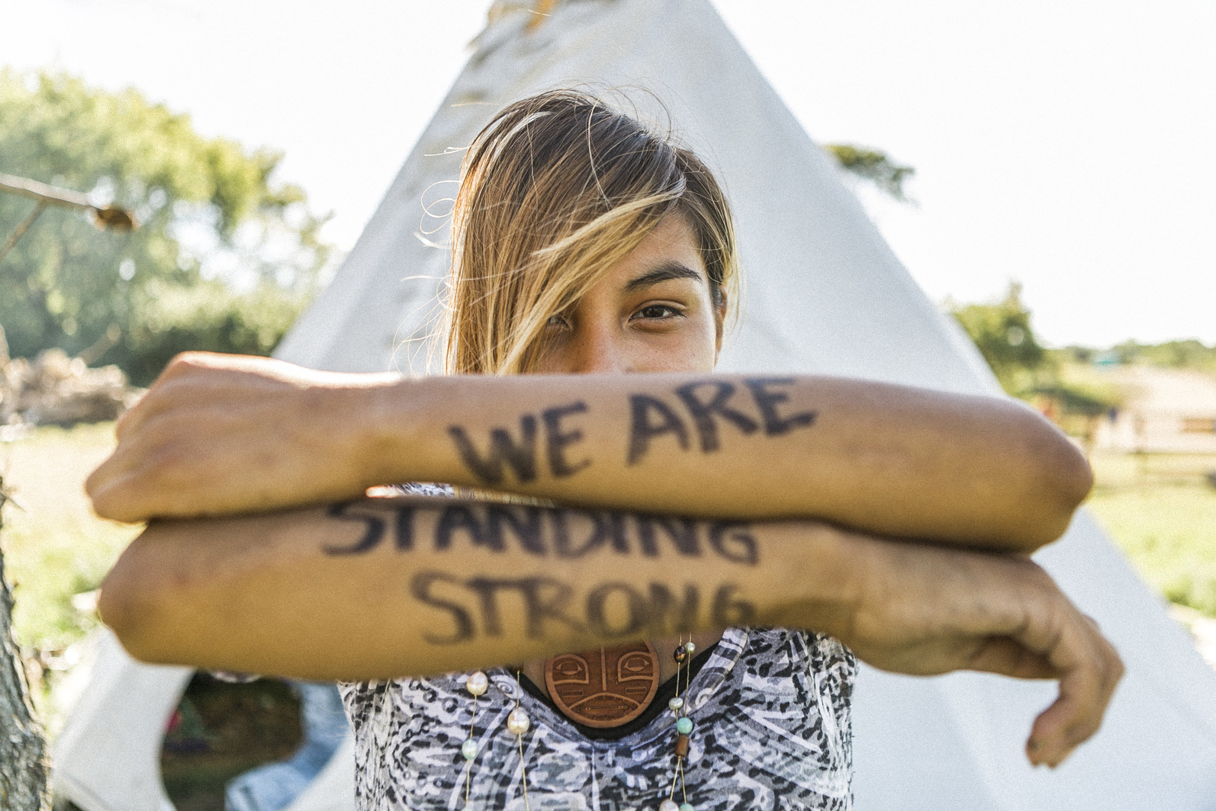 Jusilea Charger , 20, Eagle Butte, South Dakota: 'I would do anything for our children, so now I have to fight so they won't have to later. We continue to stand strong for generations to come.'