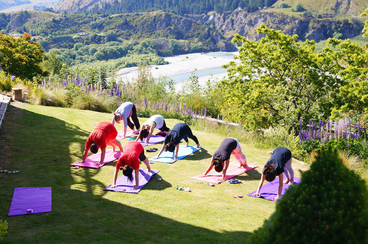 Downward dog during a healthy hens party in Queenstown