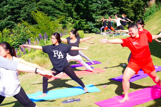 Healthy Hens party guests striking an impressive warrior pose