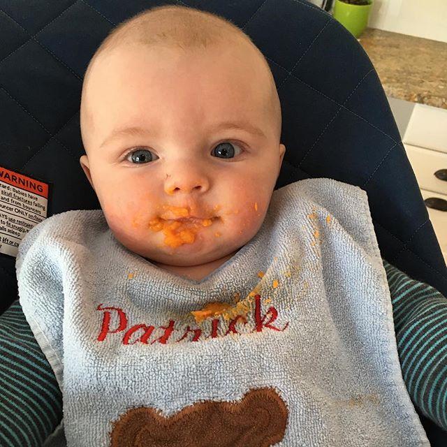 We like sweet potatoes like mommy! And wearing our uncles bibs! . . . #firstfoods #sweetpotato #yum #baby #5months #gettingtoobig #potatohead #handmedown #mynameistommy