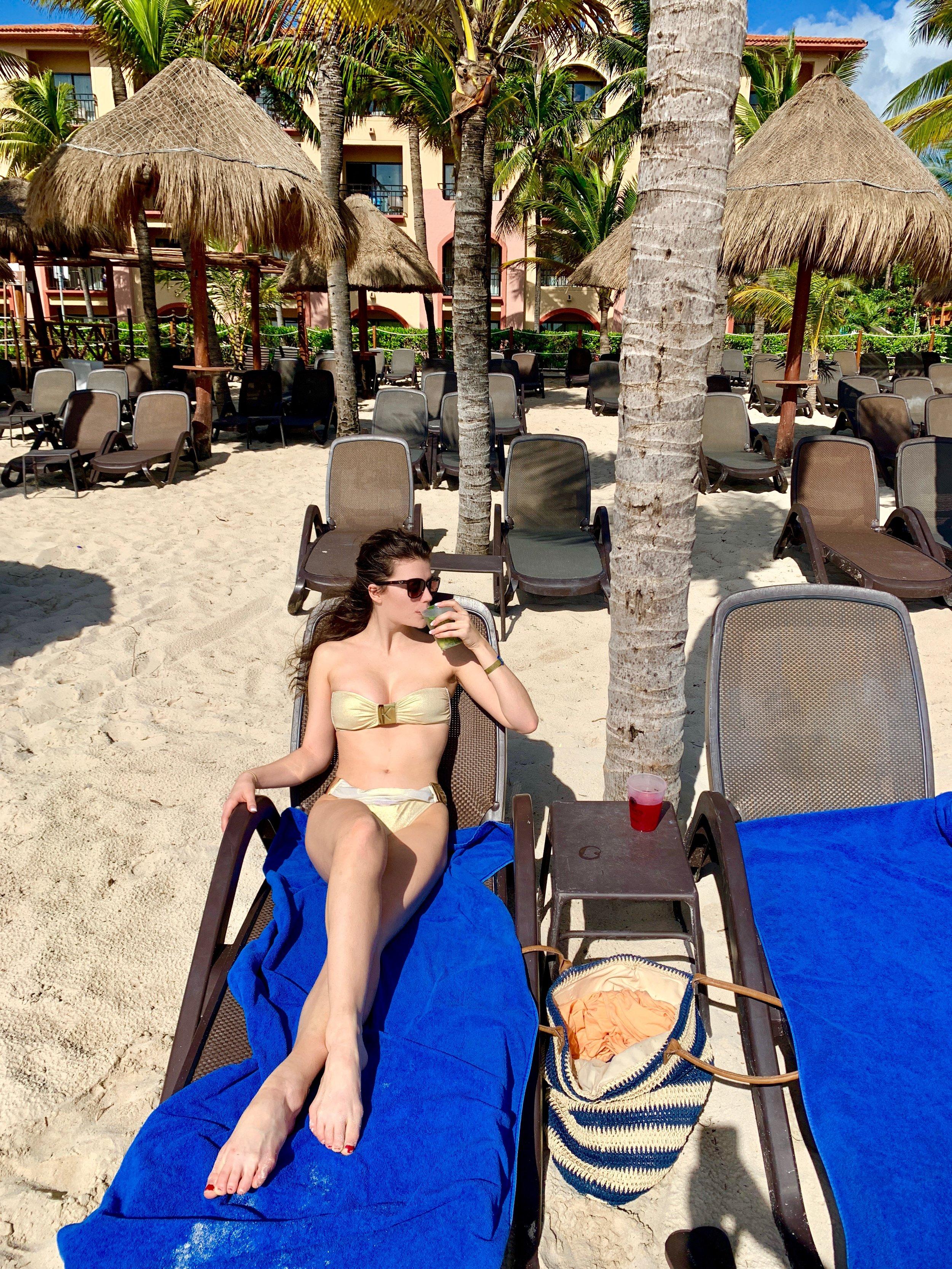 Sipping on a delicious mojito at the Sandos Playacar Resort!