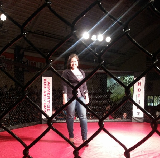Emy Cee performing at an MMA match