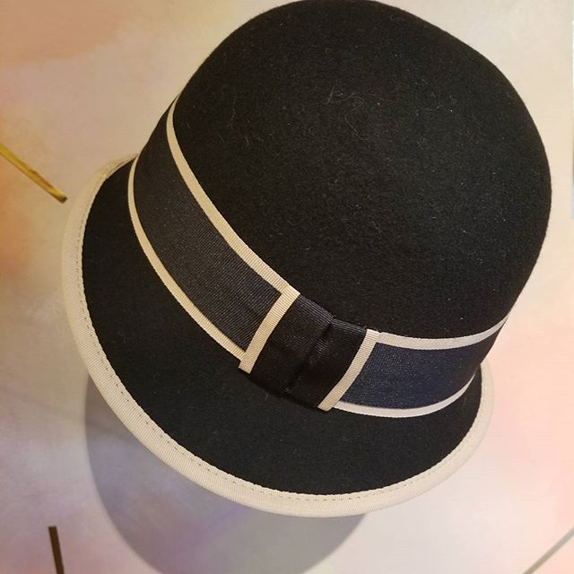 Make a bad hair day great. Black hat with tan trim, order today 212.996.7980