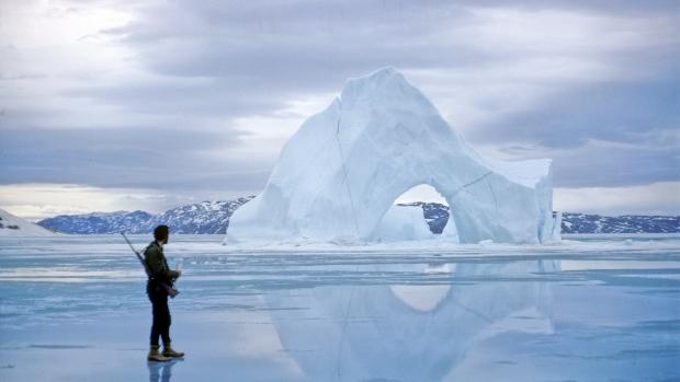 John England on the spring sea ice of Ekalugad Fiord, eastern Baffin Island, Nunavut, 1965. (Tim Sookocheff)