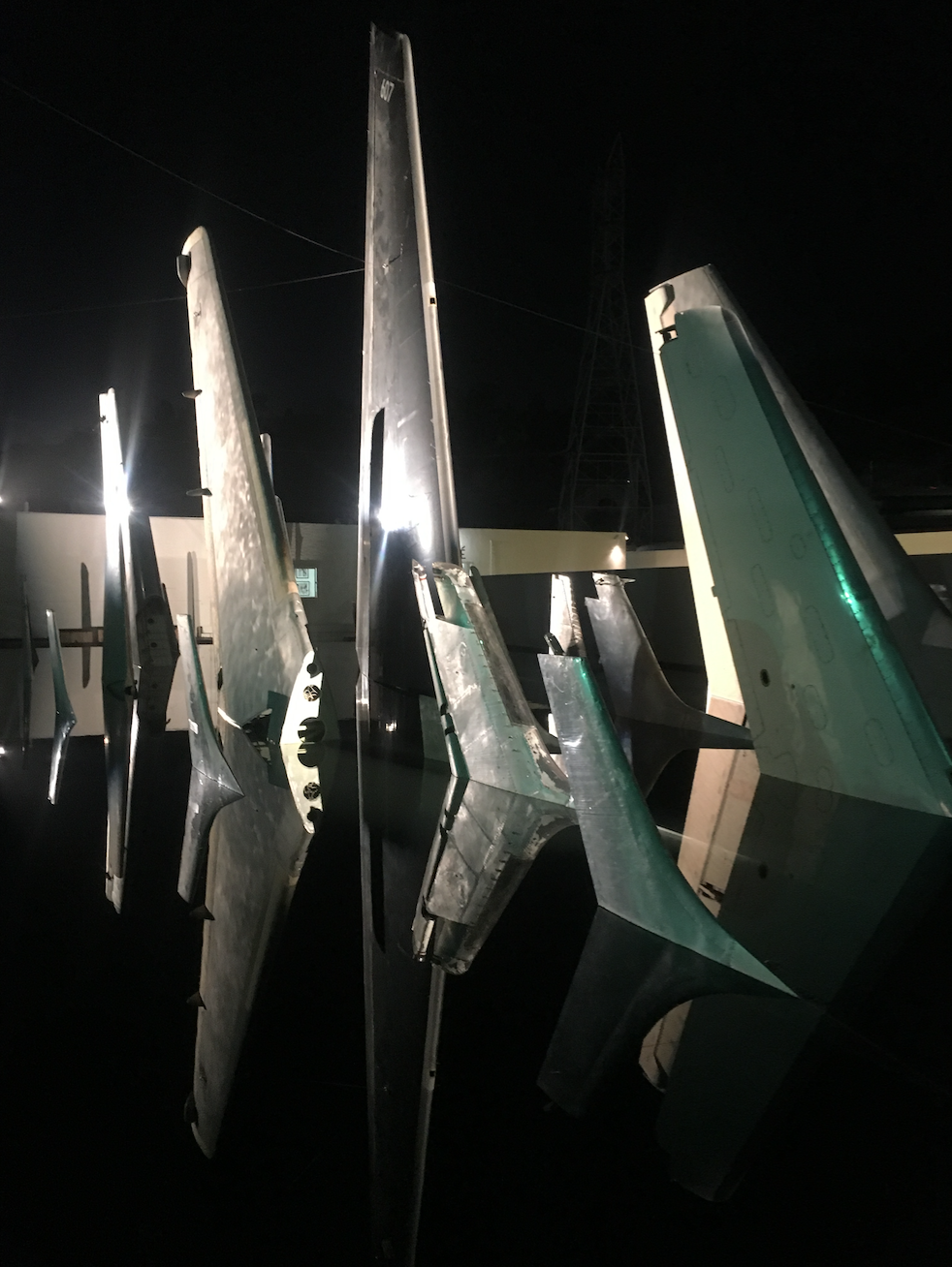 Clean Air Turbulence (The Portent)   The 14th Factory - Simon Birch Site-specific installation: Salvaged airplane tails in steel-framed pool Aluminum, steel, paint, water, ink, 2016-17