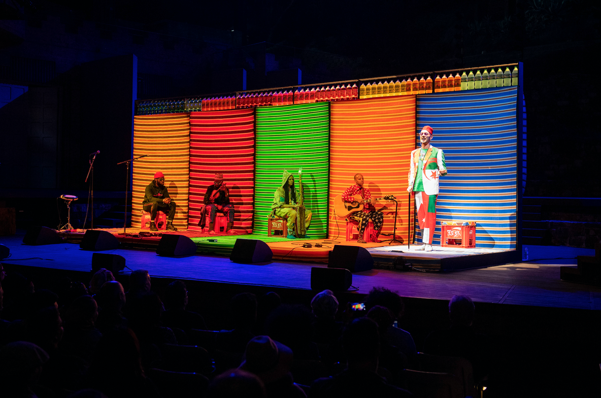 Omar Offendum in the spotlight. Hassan Hajjaj's MY ROCKSTARS EXPERIMENTAL LIVE at the Ford Theatres. Photograph by Timothy Norris