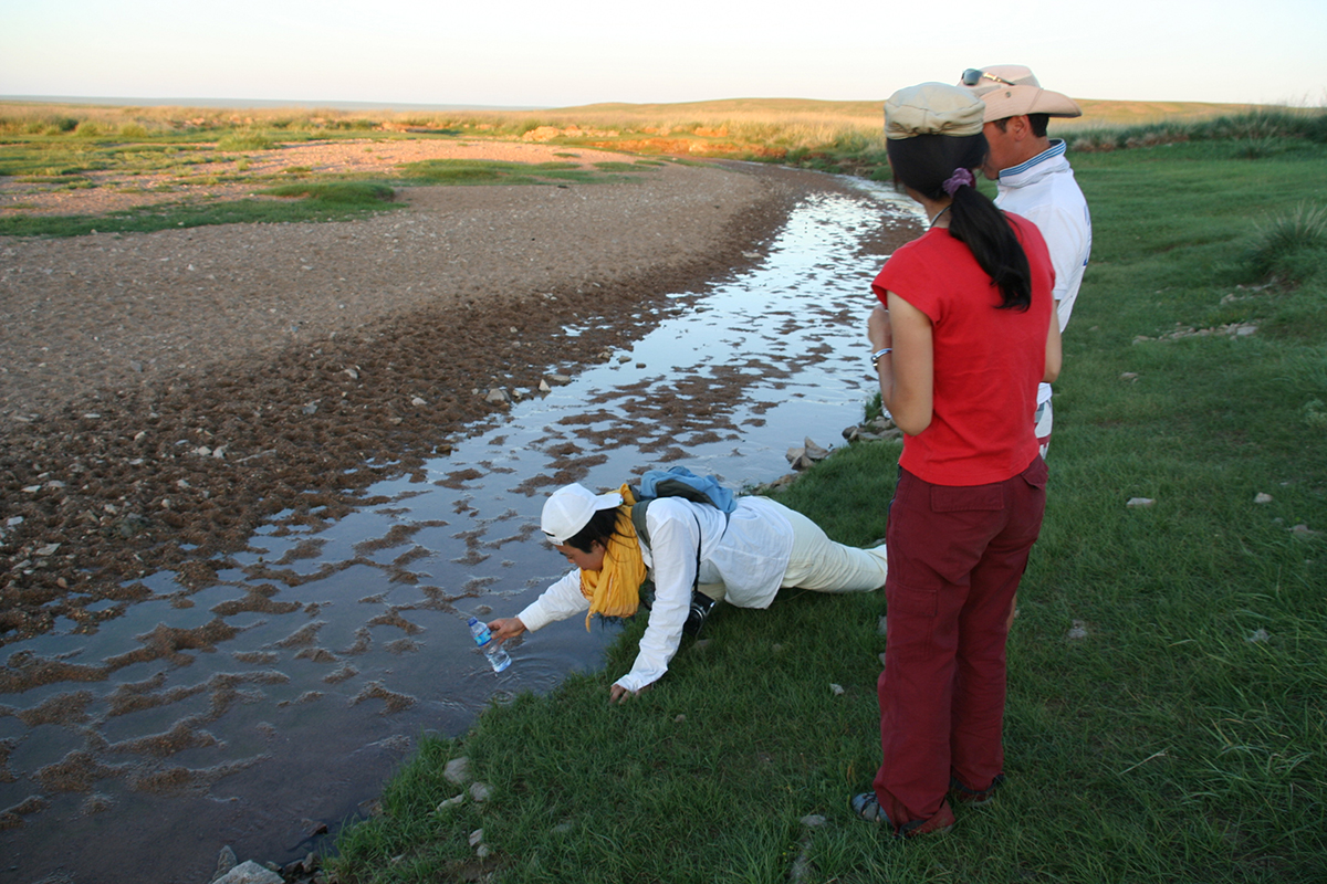 collecting water at Holy Well Gobi.jpg