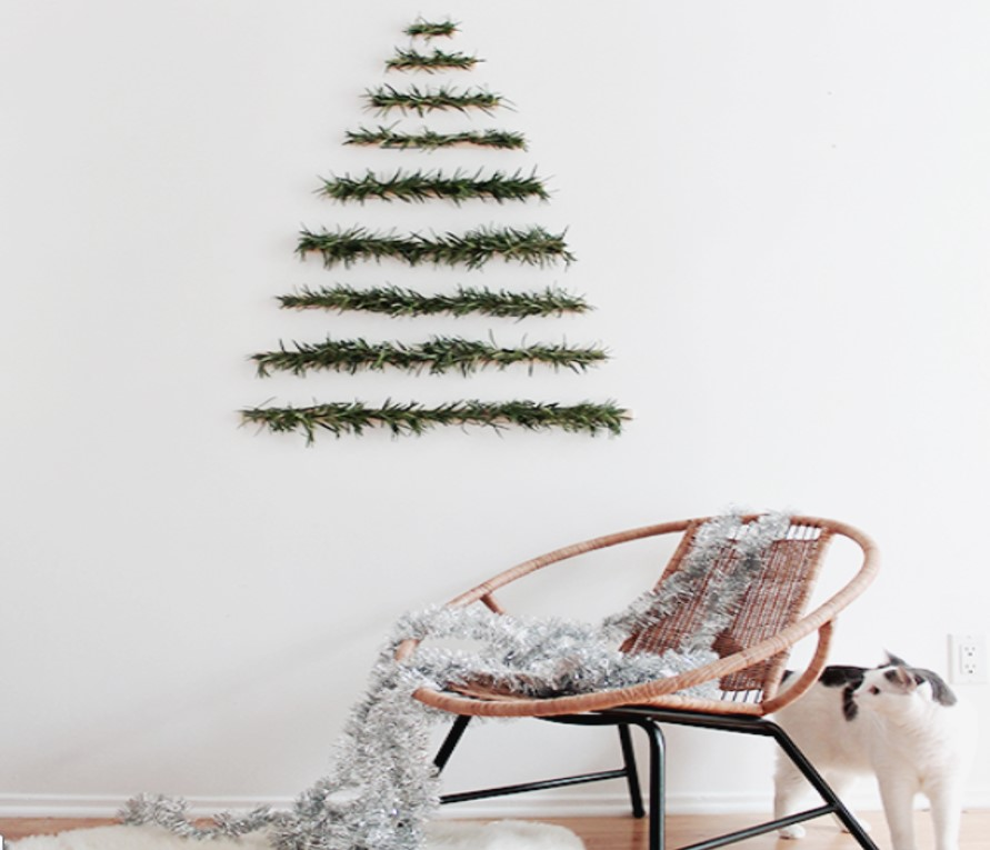 For more information on how you can create this simple, yet effective Xmas tree click here...   http://www.almostmakesperfect.com/2014/12/03/diy-makeshift-xmas-tree-wall-hanging/