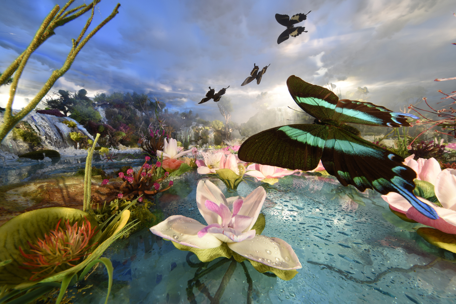 Green butterfly with pink lilies