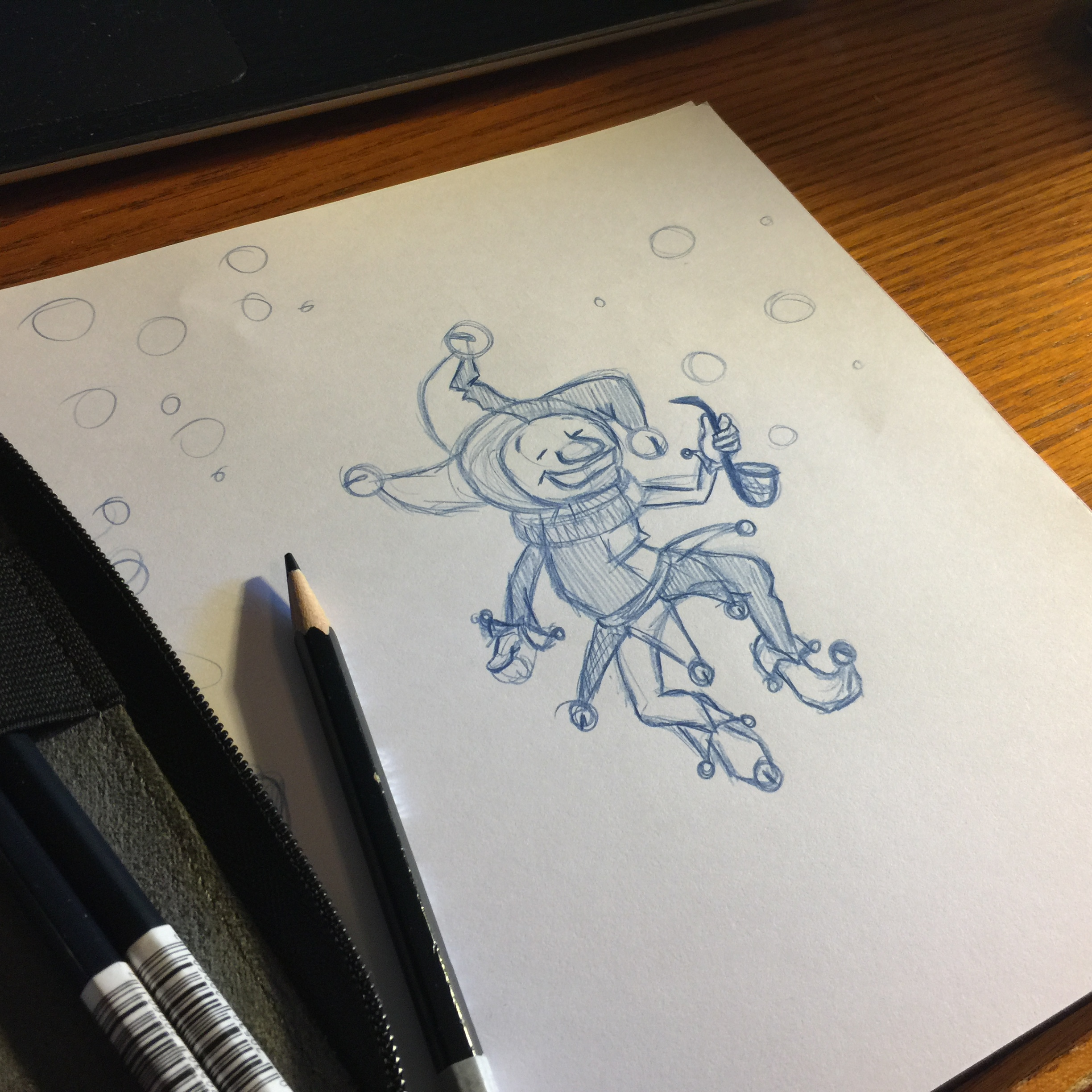 Pencil sketch of jester with bubble pipe.