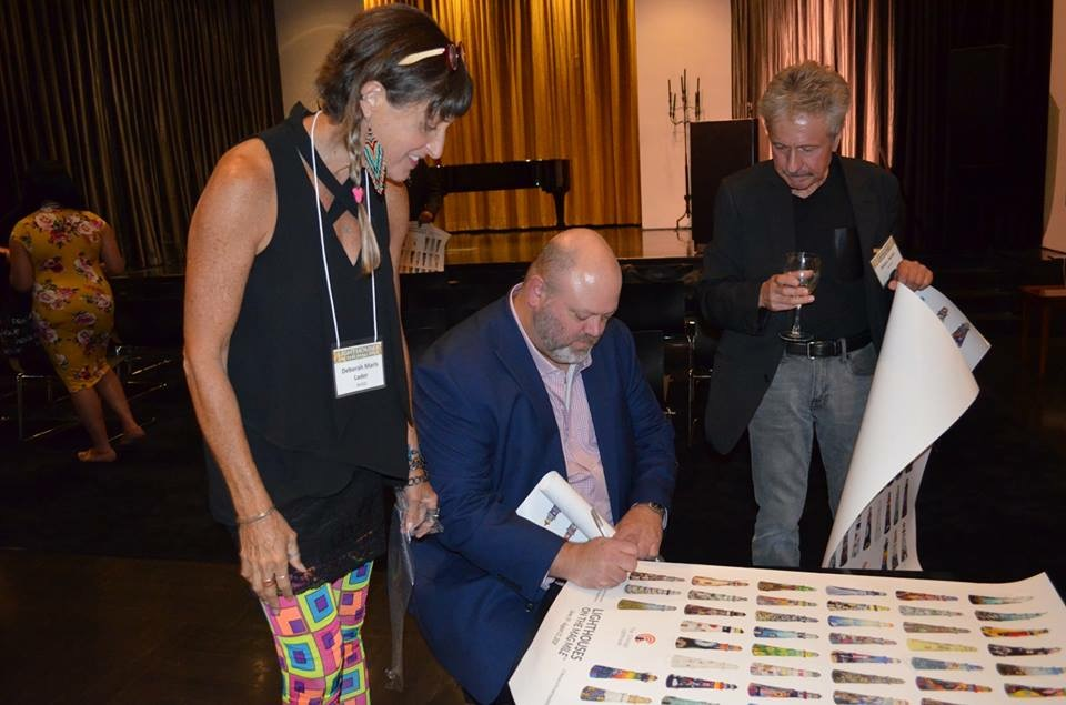 Signing posters with fellow artists Deborah and Didier