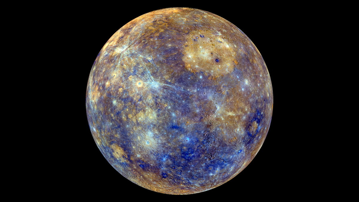 Mercury in false color. False color is when different wavelengths outside of the human range or different mineralogical makeups are represented by colors we can see. Credit: NASA.