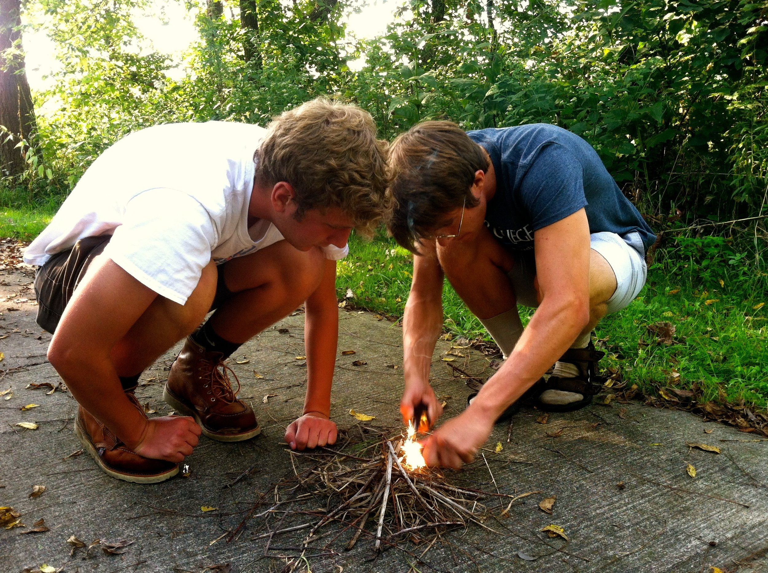 Bluestem students lighting a fire with flint