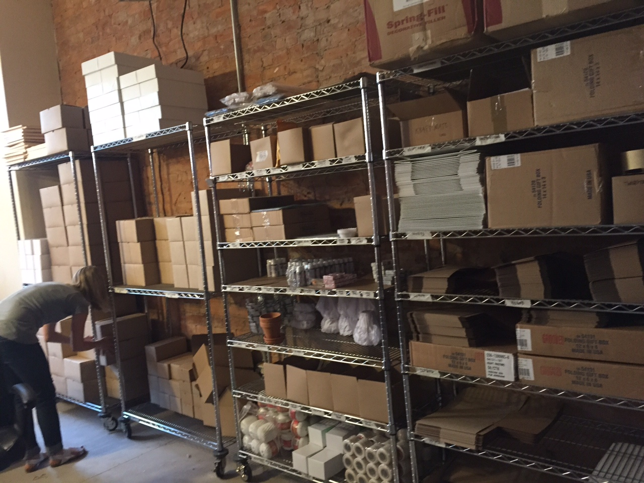 GILD Collective's first warehouse, with shelves full of crafting supplies.