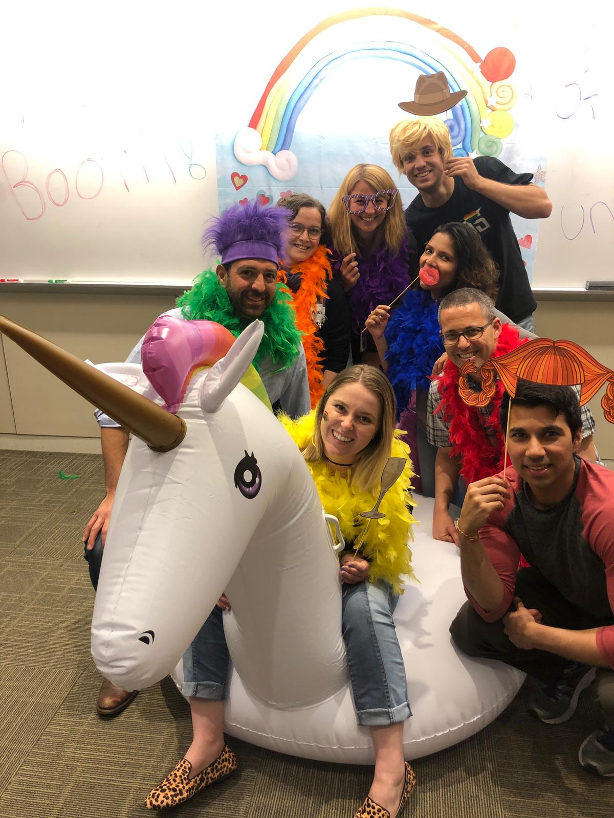 Lab photo with our honorary member Jamie the unicorn at the LGBTQ+ Happy Hour.