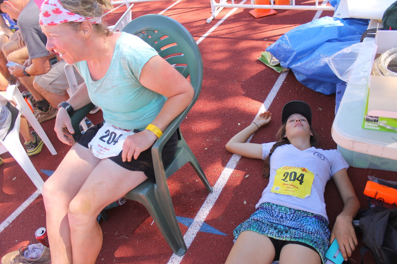 Naomi (right) takes a load off after running a 40-mile section of WS100 as a pacer for her friend.