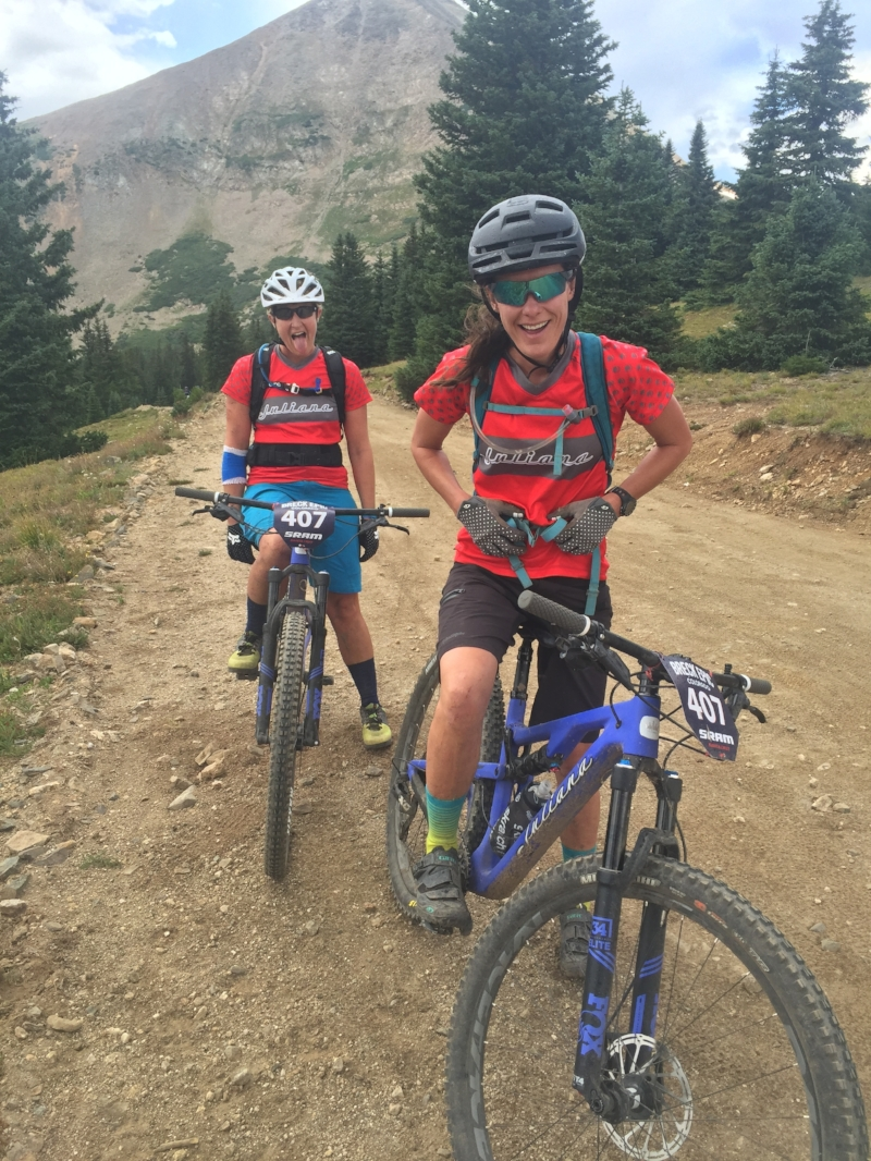 Uri + her partner, smiling through BreckEpic with grit and grace.