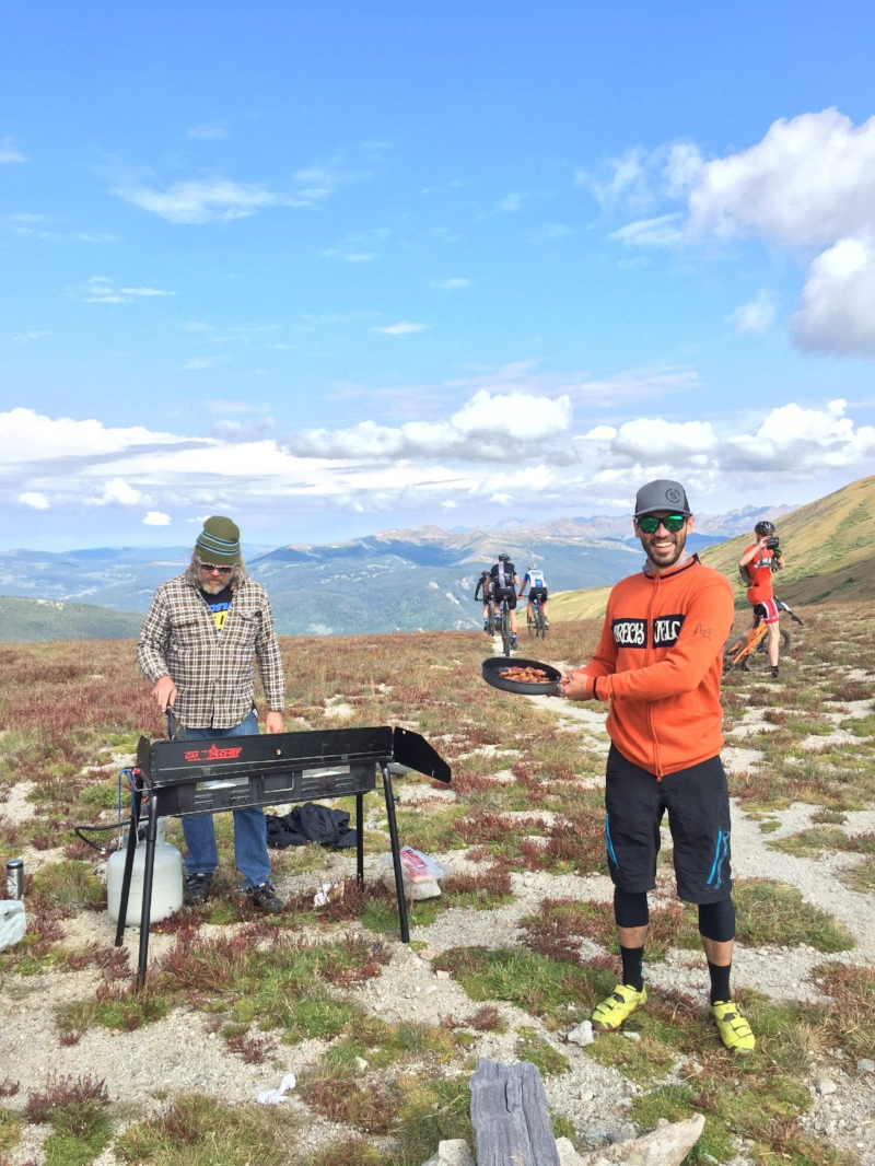 Uri's husband Jeff waits at the top of Wheeler Pass on the BreckEpic course to serve his wife freshly cooked bacon.