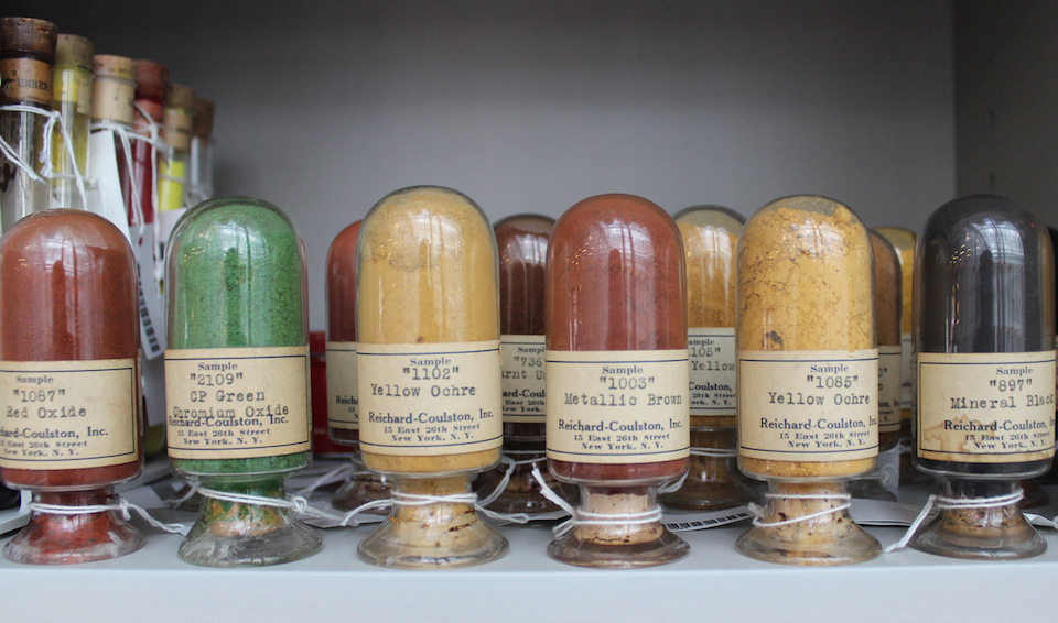 rounded glass vials holding various colors of pigment