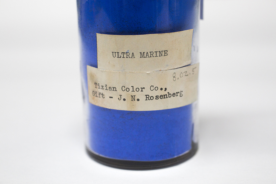 glass bottle filled with blue pigment
