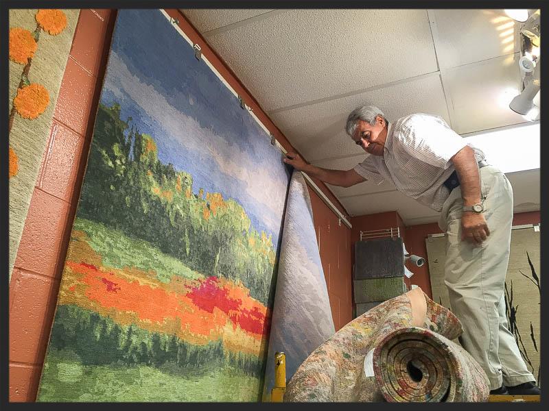 Reza Sattari removes the 8x10 Wool and Silk carpet entitled Nature...